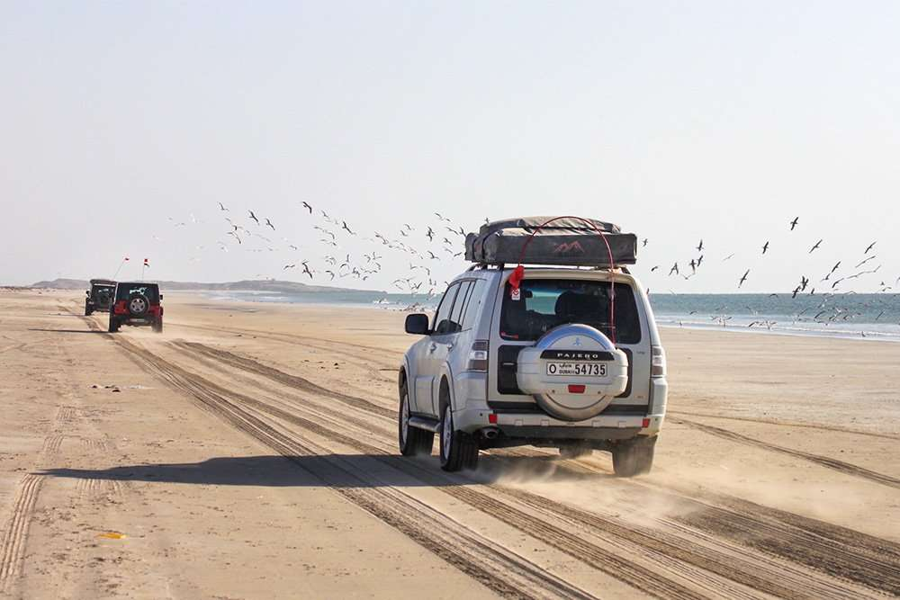 4x4 on beach Oman during 8 day expedition